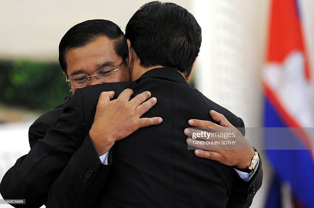 Vietnam's Prime Minister Nguyen Tan Dung (back to camera) hugs Cambodian Prime Minister Hun Sen (L-facing) during their meeting at the Peace Palace in Phnom Penh on February 4, 2013. Dung arrived here to pay his respects and attend the funeral of the late former king Norodom Sihanouk ahead of his cremation on February 4.