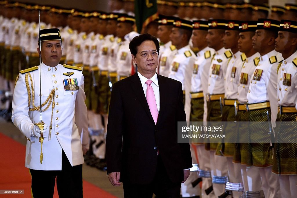 Vietnam's Prime Minister <a gi-track='captionPersonalityLinkClicked' href=/galleries/search?phrase=Nguyen+Tan+Dung&family=editorial&specificpeople=544511 ng-click='$event.stopPropagation()'>Nguyen Tan Dung</a> inspects a ceremonial guard of honour during a welcoming ceremony at the Malaysian prime minister's office in Putrajaya on August 7, 2015. Dung is on a two-day visit to Malaysia.