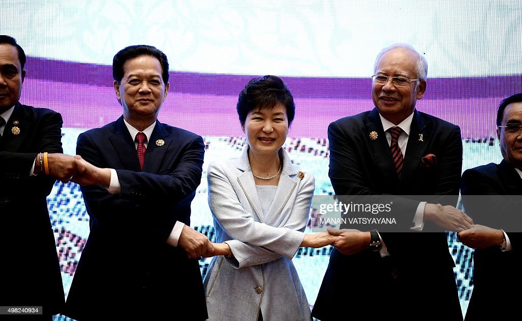 Vietnam's Prime Minister Nguyen Tan Dung South Korean President Park Geunhye and Malaysia's Prime Minister Najib Razak pose for a family photo at the...