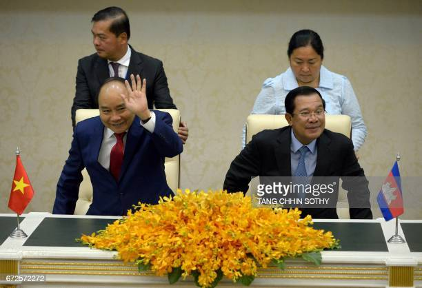 Vietnam's Prime Minister Nguyen Xuan Phuc and Cambodia's Prime Minister Hun Sen sit during a signing ceremony at the Peace Palace in Phnom Penh on...