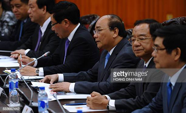 Vietnam's Prime Minister Nguyen Xuan Phuc and his entourage hold official talks with US President Barack Obama at Phuc's cabinet office in Hanoi in...