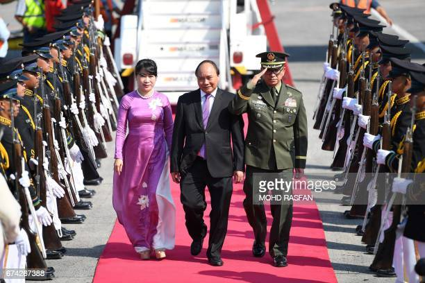 Vietnam's Prime Minister Nguyen Xuan Phuc and his wife Tran Nguyet Thu arrive for the Association of Southeast Asian Nations summit in Manila on...