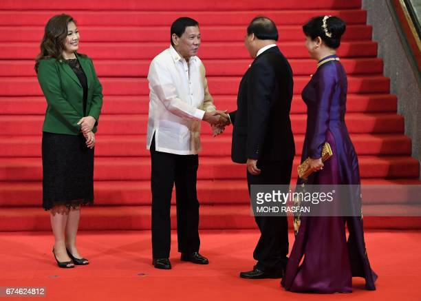 Vietnam's Prime Minister Nguyen Xuan Phuc and his wife Tran Nguyet Thu are welcomed by Philippine President Rodrigo Duterte and his partner Honeylet...