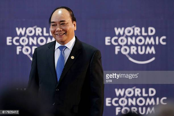 Vietnams Prime Minister Nguyen Xuan Phuc arrives for the opening ceremony of World Economic Forum on Mekong region in Hanoi on October 25 2016 / AFP...