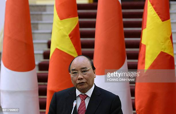 Vietnam's Prime Minister Nguyen Xuan Phuc speaks during a joint press briefing with his Japanese counterpart Shinzo Abe in Hanoi on January 16 2017...