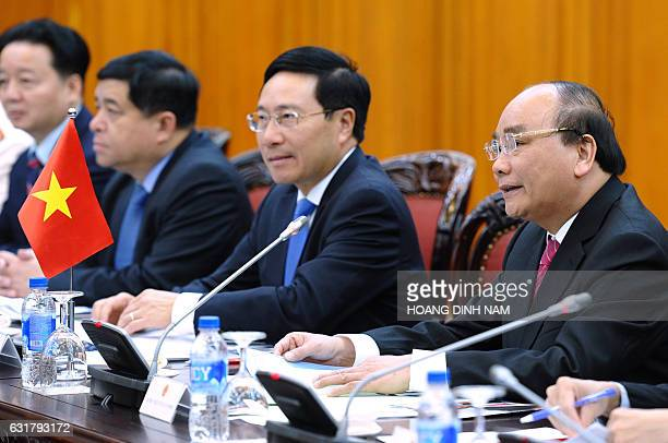 Vietnam's Prime Minister Nguyen Xuan Phuc speaks during official talks with Japan's Prime Minister Shinzo Abe at Phuc's Cabinet Office in Hanoi on...