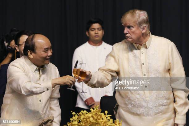 Vietnam's Prime Minister Nguyen Xuan Phuc toasts with US President Donald Trump during a special gala celebration dinner for the Association of...