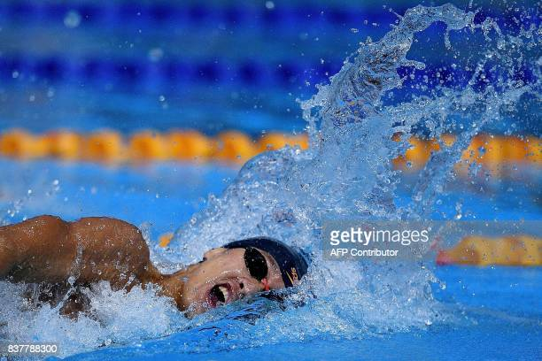 Vietnam's Quy Phuoc Hoang competes in the men's swimming 200m freestyle final event of the 29th Southeast Asian Games at the National Aquatics centre...
