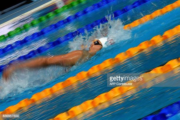 Vietnam's Thi Anh Vien Nguyen competes in the women's 200m backstroke swimming final of the 29th Southeast Asian Games at the National Aquatics...