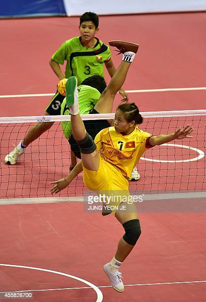 Vietnam's Thi Xuyen Duong strikes the ball against Myanmar in the women's double preliminary group B sepaktakraw match during the 2014 Asian Games at...