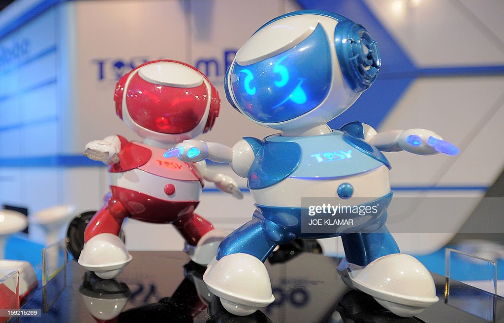 Vietnam's Tosy Disco Robots are displayed at the 2013 International CES at the Las Vegas Convention Center on January 9, 2013 in Las Vegas, Nevada. CES, the world's largest annual consumer technology trade show, runs from January 8-11 and is expected to feature 3,100 exhibitors showing off their latest products and services to about 150,000 attendees.AFP PHOTO / JOE KLAMAR
