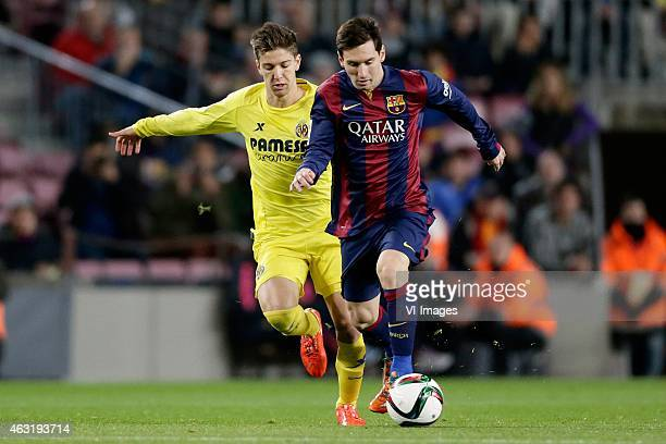 Vietto of Villarreal CF Lionel Messi of FC Barcelona during the Copa del Rey match between FC Barcelona and Villarreal at Camp Nou on february 11...