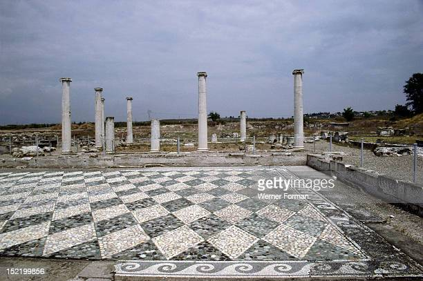 View across a black and white diamondshaped pebble mosaic floor at Pella the Macedonian capital and birthplace of Alexander the Great Greece Ancient...