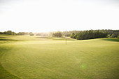 View across golf green at sunrise.