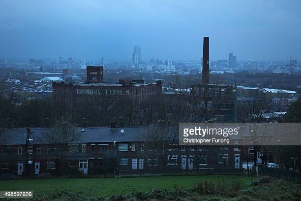 A view across Oldham and former cotton mills with Manchester on the horizon The mills of the north made the Cotton Towns some of the wealthiest...