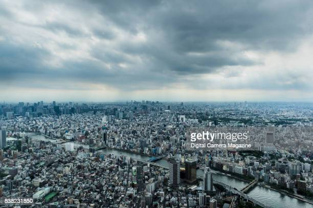 View across the city of Tokyo Japan photographed from the observation deck of the Tokyo Skytree building taken on June 14 2016 The Sumida River is...