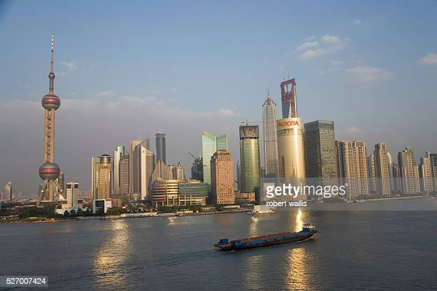 View across the Huangpu River with Pudong's skyscrapers in the background The Oriental Pearl Tower is on the left and The Shanghai World Finance...