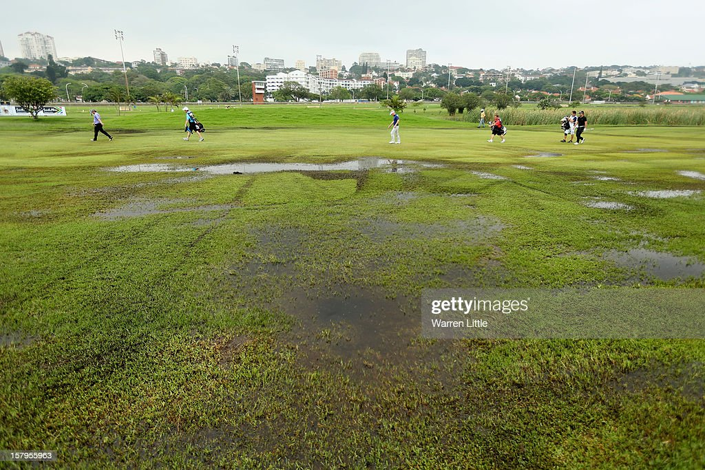 A view across the water logged course as players make their way down a fairway during the first round of The Nelson Mandela Championship presented by ISPS Handa at Royal Durban Golf Club on December 8, 2012 in Durban, South Africa.