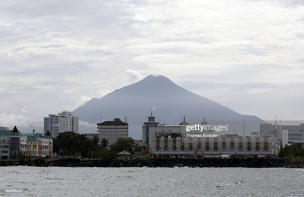A view across the water of the volcano behind the town of Manado, Indonesia on January 11, 2013.