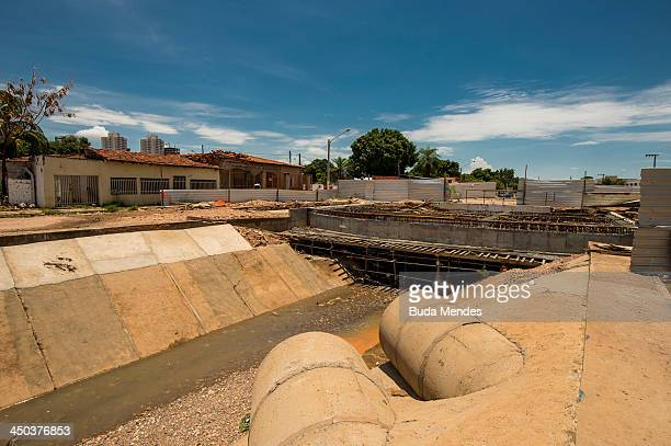 A view across towards a community bordering the construction site around the Arena Pantanal on November 17 2013 in Cuiaba Brazil Court cases are...