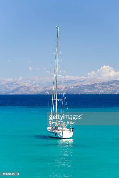 View across turquoise water, Lakka, Paxos, Greece