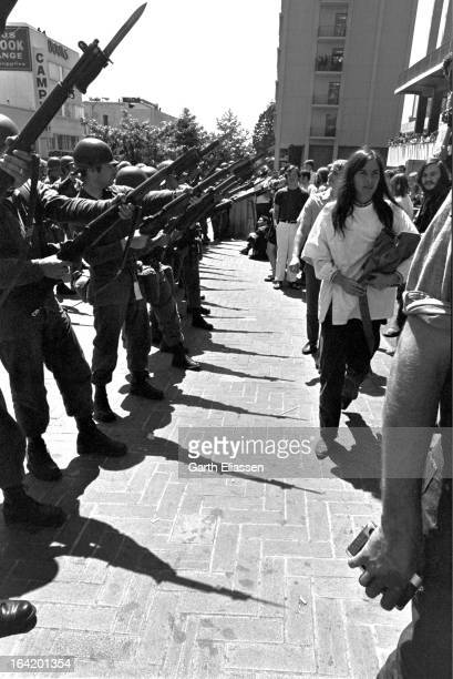 View along a California National Guardsmen bayonets at the ready during protests near People's Park on the campus of the University of Berkeley...