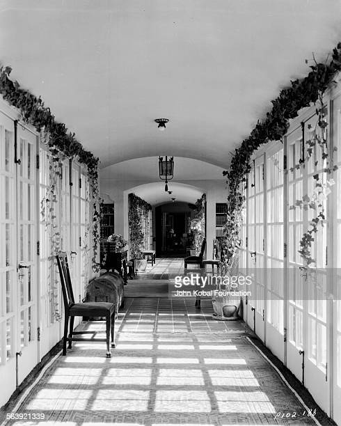 A view along a long corridor in the home of filmmaker Cecil B DeMille 1949