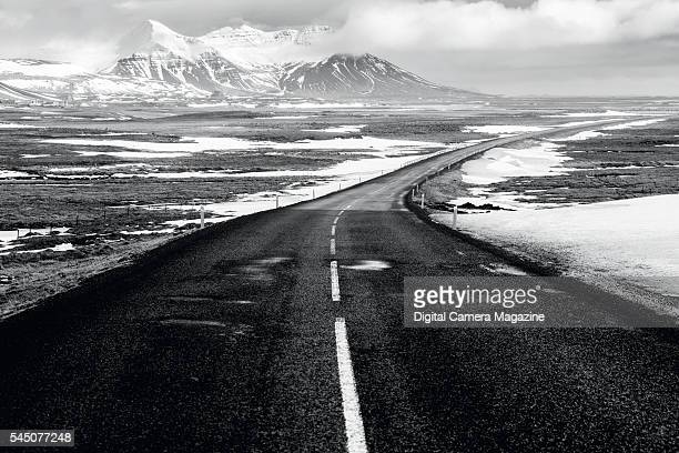 View along a road curving across a mountainous landscape in Iceland on October 11 2014