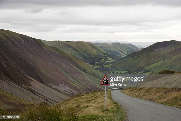 View along a valley in the Cambrian Mountains from a point of natural beauty towards Llanymawddwy Wales UK A warning sign showing that there may be...