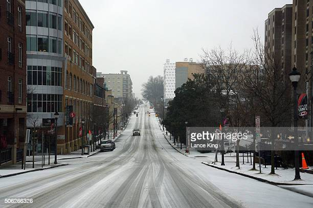 A view along Glenwood Avenue during a winter storm on January 22 2016 in the Glenwood South District of Raleigh North Carolina A major snowstorm is...