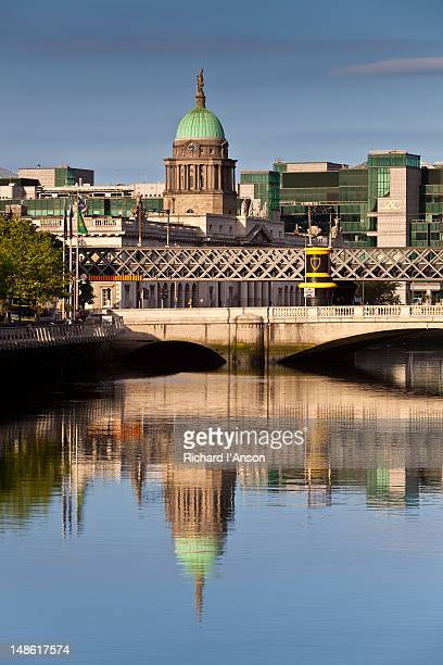 View along Liffey River to Butt Bridge, Customs House and International Financial Services Centre.