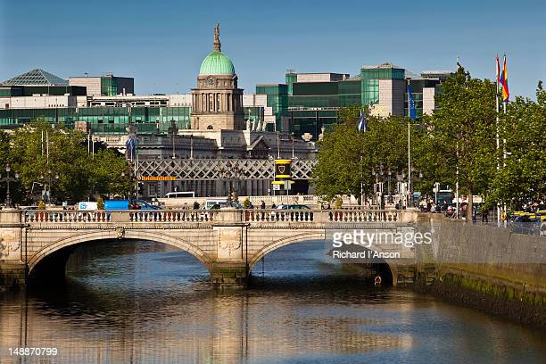 View along Liffey River to O'Connell Bridge, Customs House and International Financial Services Centre.