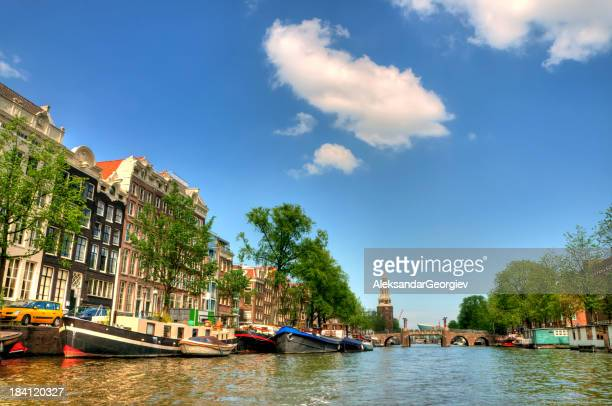 View along Singel canal in Amsterdam to Munttoren tower