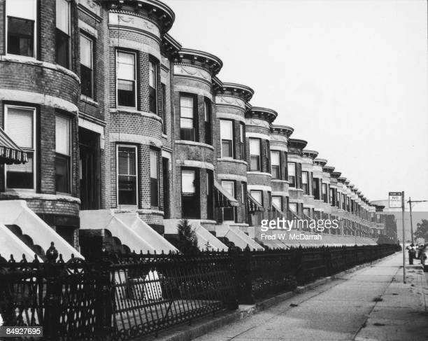 View along the facades of nearly identical row houses an unidentified street in the Bay Ridge neighborhood of Brooklyn New York August 16 1959