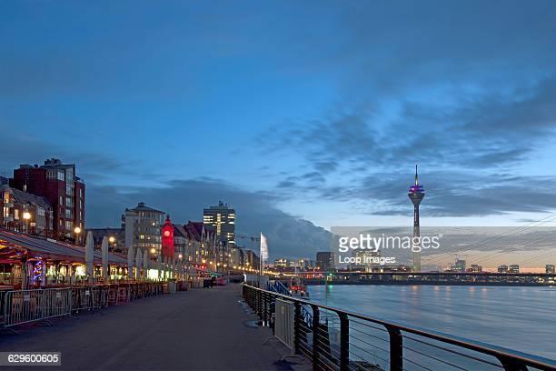 View along the promenade towards the TV tower in Dusseldorf Dusseldorf Germany