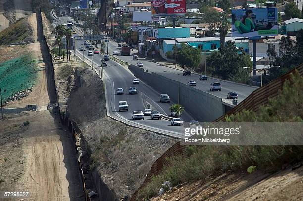 A view along the western USMexican border shows the rudimentary metal fence put up by the US to keep people from crossing the Tijuana Mexico border...