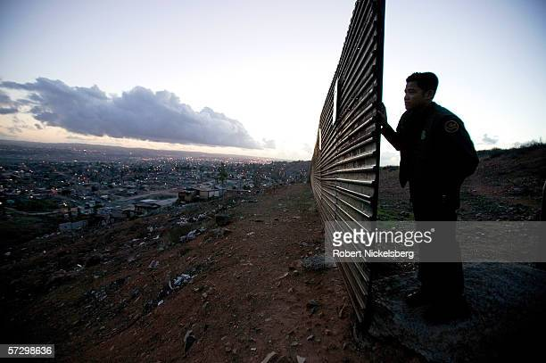 A view along the western USMexican border shows the rudimentary metal fence put up by the US to keep people from crossing the Tijuana Mexico...