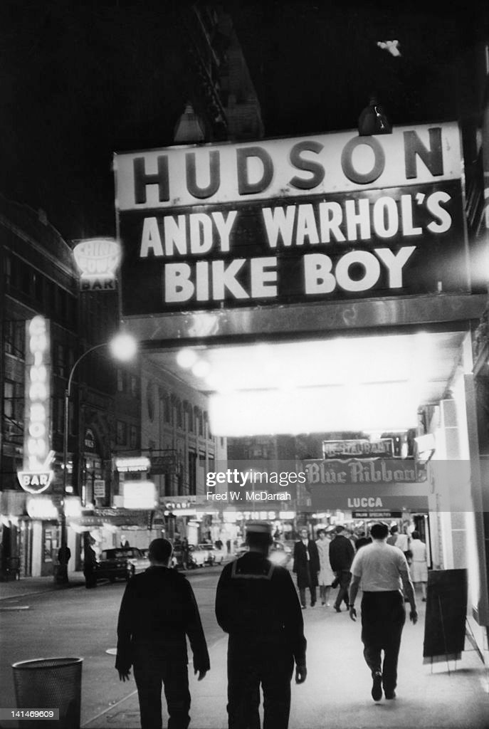 View along West 44th Street where the Hudson Theatre marquee advertises Andy Warhol's 'Bike Boy,' New York, New York, November 3, 1967.