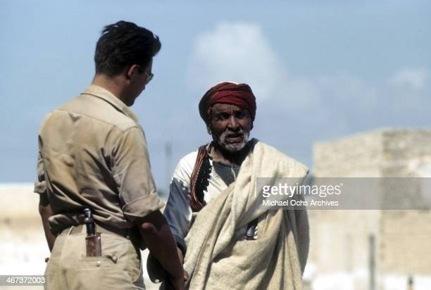 A view as a local Libyanese man talks to a service man in the street of Benghazi Libya