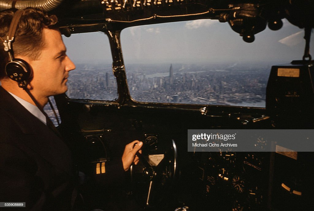 A view as a pilot sits in the cockpit as he flies a Convair Liner for American Airlines over New York.
