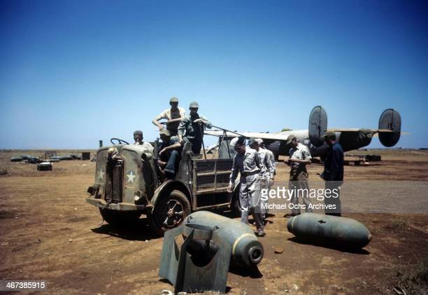 A view as crew members of the 98th Bombardment Group get a ride back to base as bombs lay on the ground at the US Air Force Base in Benghazi Libya