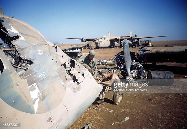A view as crew members of the 98th Bombardment Group work on wreckage at the US Air Force Base in Benghazi Libya