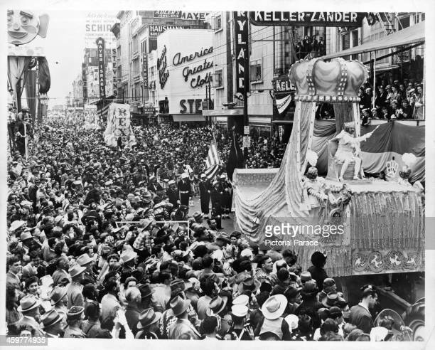 A view as floats travel down Canal street for MardiGras in New Orleans Louisiana Circa 1950