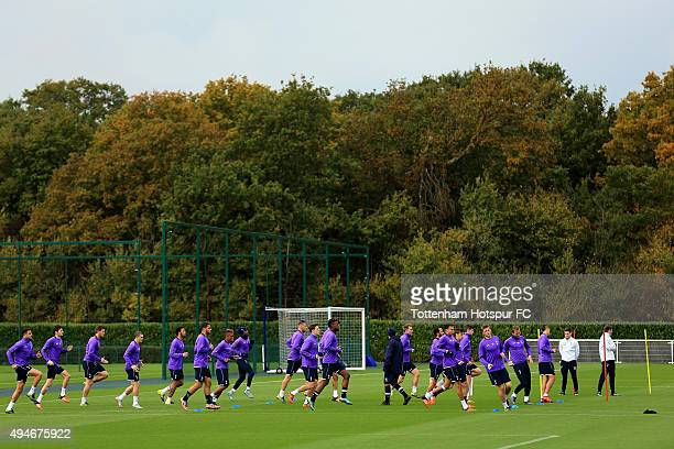 A view as players of Tottenham Hotspur warm up during a training session at the clubs training ground on October 28 2015 in Enfield England