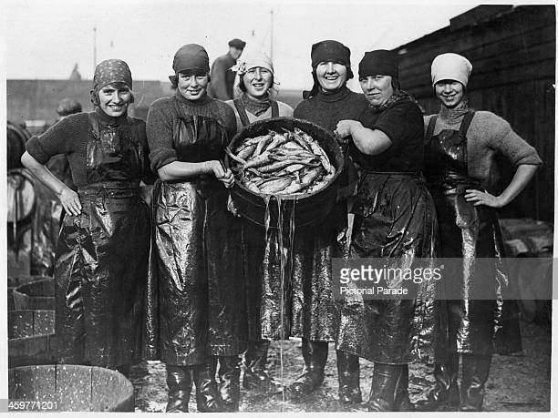A view as Scotch fishing girls examine their herring catch at Yarmouth Scotland Circa 1900