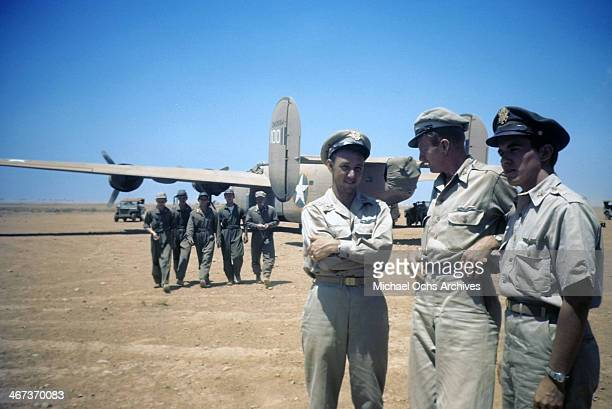 A view as the 376th Bombardment Group meet as crew members of the B24Liberators walk in the background at the US Air Force Base in Benghazi Libya