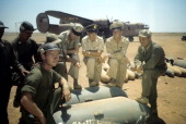 A view as the 376th Bombardment Group pose with a B24 Liberator in the background at the US Air Force Base in Benghazi Libya
