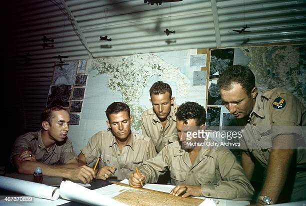 A view as the Colonel KK Compton of the 376th Bombardment Group leads a meeting in a map room at the US Air Force Base in Benghazi Libya