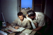 A view as the Colonel KK Compton of the 376th Bombardment Group reviews papers at the US Air Force Base in Benghazi Libya KK Compton