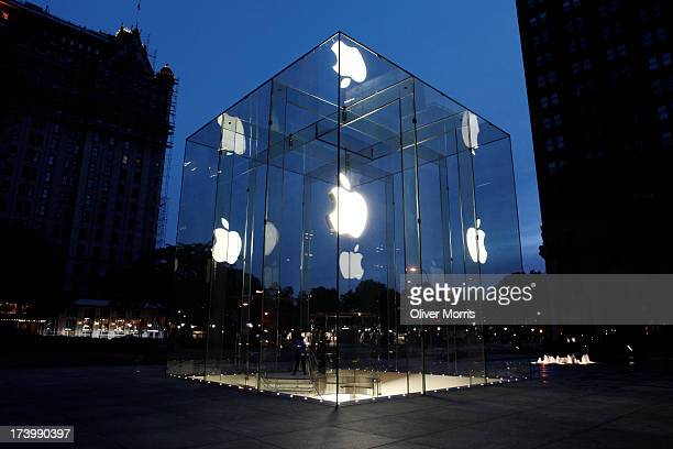 A view at daybreak of the illuminated extrance to the Apple 24hour store designed by Bohlin Cywinski Jackson Manhattan New York May 28 2013